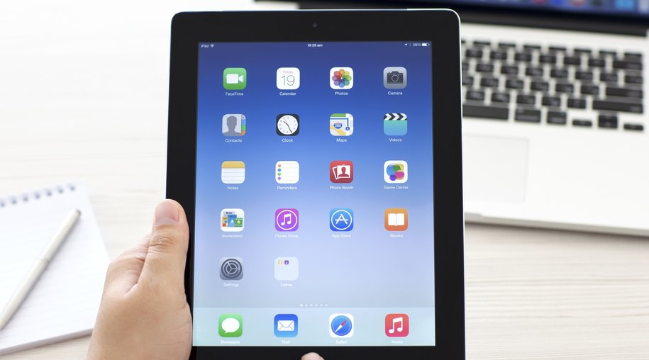 Simferopol, Russia - September 19, 2014: Apple iPad displaying iOS 8 homescreen. iOS 8 mobile operating system designed by Apple Inc. is an upcoming September 17, 2014.