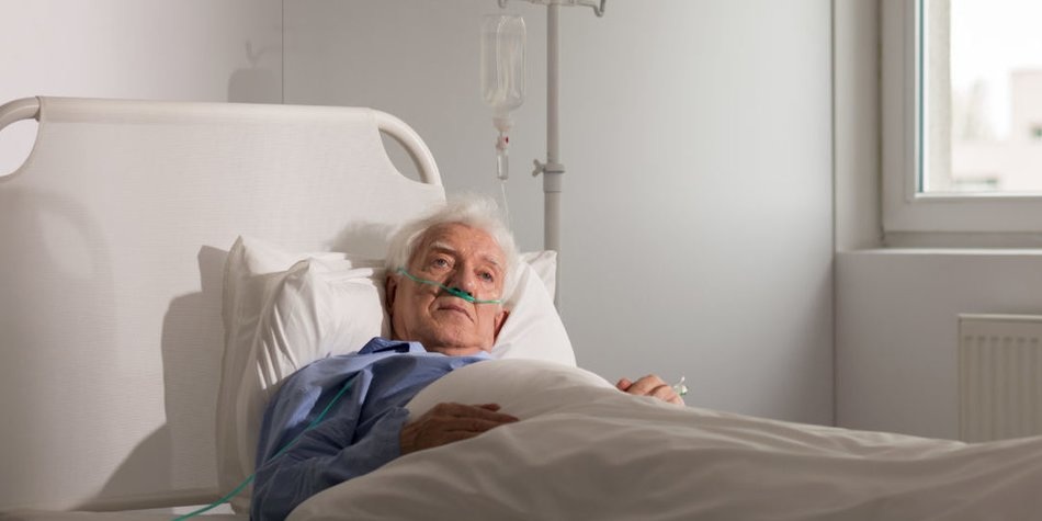 Lonely sad terminally ill patient in hospital bed