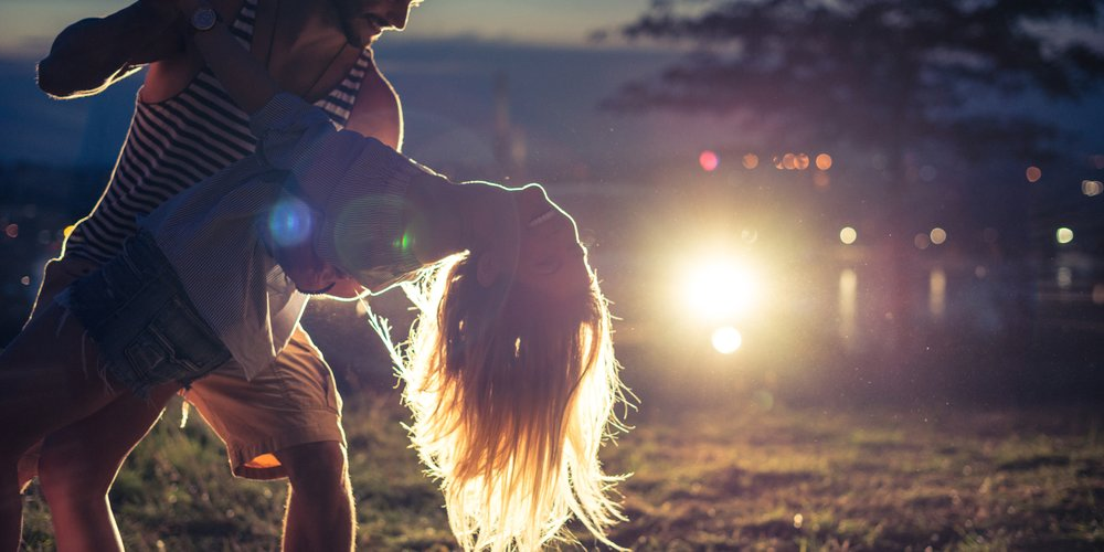 Couple dancing together on a evening party.