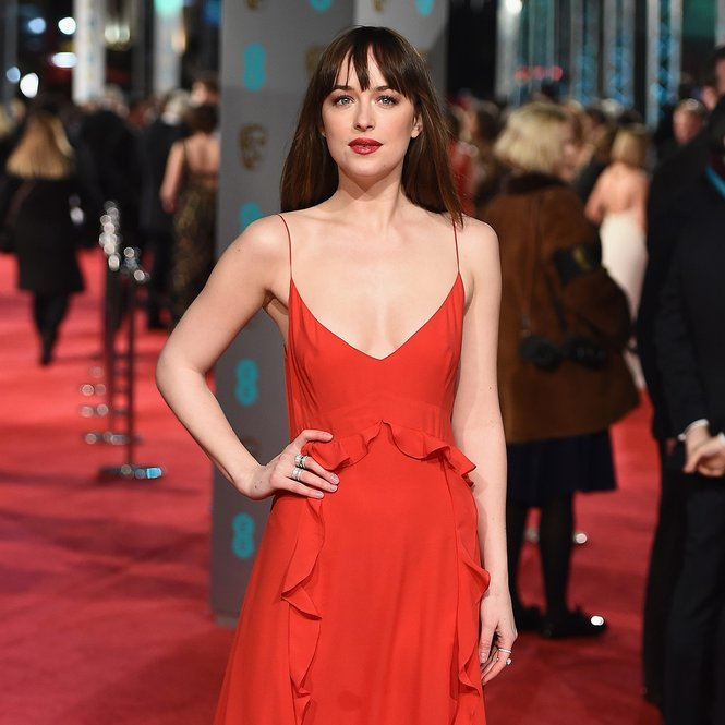 LONDON, ENGLAND - FEBRUARY 14: Dakota Johnson attends the EE British Academy Film Awards at the Royal Opera House on February 14, 2016 in London, England.  (Photo by Ian Gavan/Getty Images)