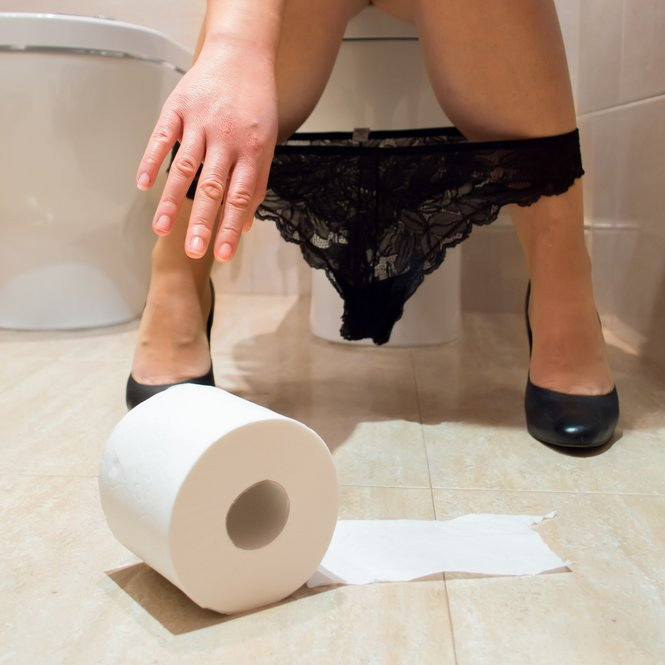 Woman taking the role of soil in a toilet