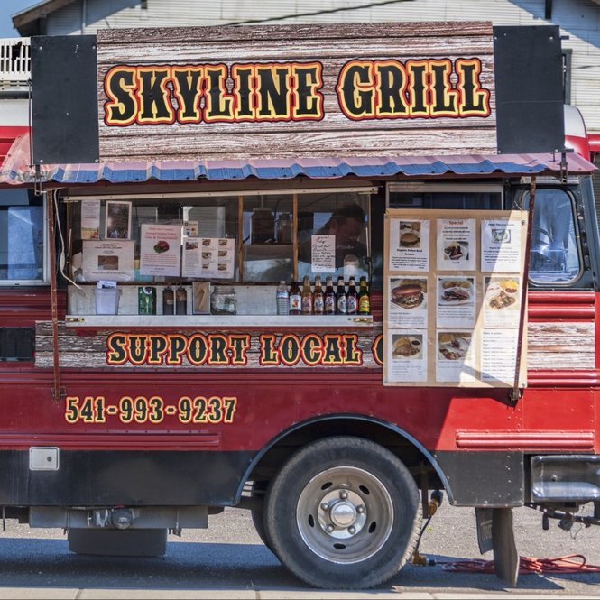 Skyline Grill food truck sporting menues and beers on the street in downtown The Dalles, Oregon,