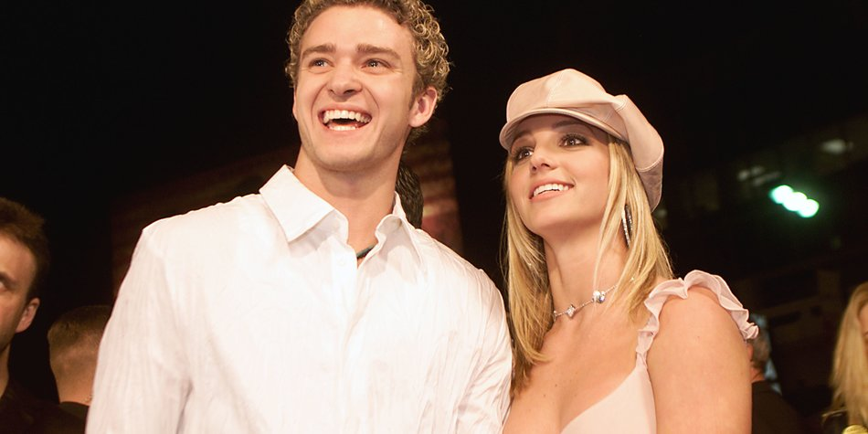 """Britney Spears and boyfriend Justin Timberlake arrive at the premiere of her movie """"Crossroads"""" at the Mann Chinese Theatre in Hollywood, Ca., Feb. 11, 2002. (photo by Kevin Winter/Getty Images)"""