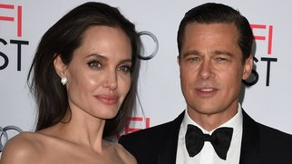 Writer-director-producer-actress Angelina Jolie Pitt (L) and actor-producer Brad Pitt arrive for the opening night gala premiere of Universal Pictures' 'By the Sea' during AFI FEST 2015 presented by Audi at the TCL Chinese Theatre in Hollywood, California on November 5, 2015. AFP PHOTO / MARK RALSTON (Photo credit should read MARK RALSTON/AFP/Getty Images)