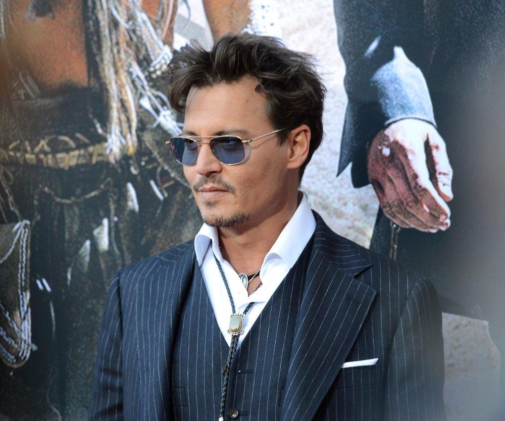 Johnny Depp spielt gern mit Barbies