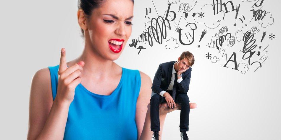 Woman yelling at a small man