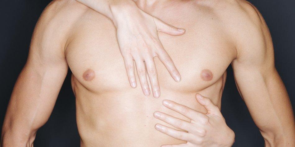 Woman hands touching a man's muscular chest