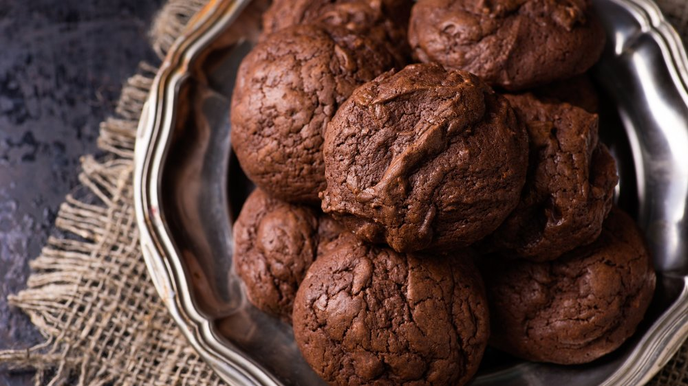 Homemade chocolate cookies on dark background, selective focus, top view