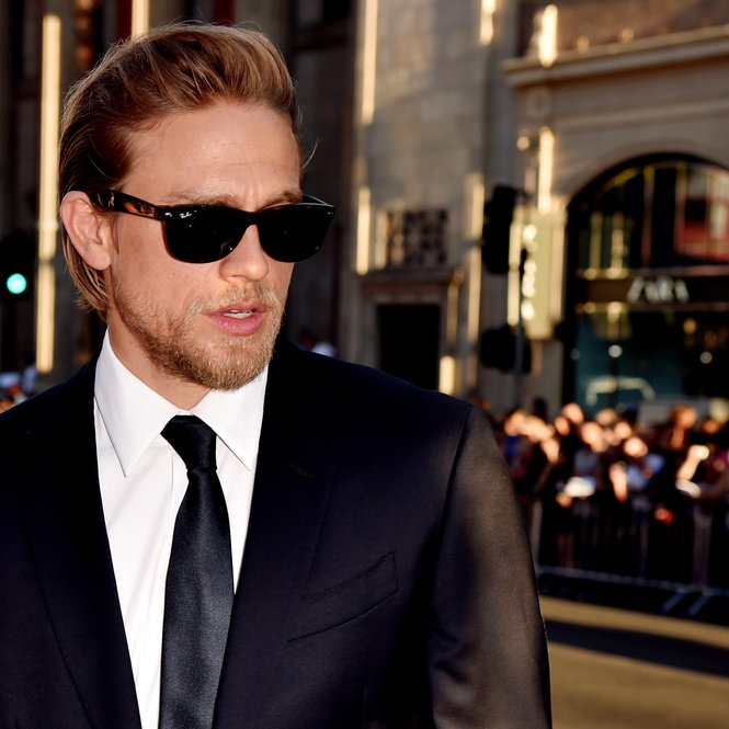 """LOS ANGELES, CA - SEPTEMBER 06: Actor Charlie Hunnam arrives at the season 7 premiere screening of FX's """"Sons of Anarchy"""" at the Chinese Theatre on September 6, 2014 in Los Angeles, California. (Photo by Kevin Winter/Getty Images)"""