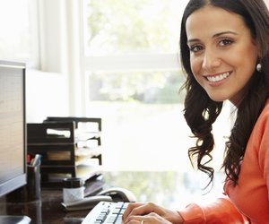 Hispanic woman working in home office