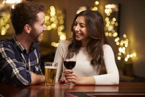 Couple Enjoying Evening Drinks In Bar