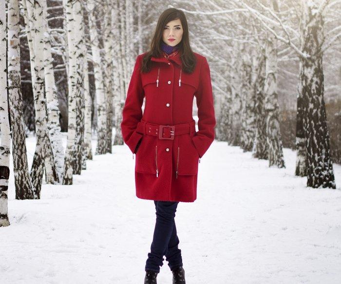Beautiful elegant woman in red coat. winter nature