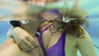 kissing romantic couple under water