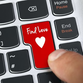 Computer keyboard key with find love and heart icon concept for online internet dating