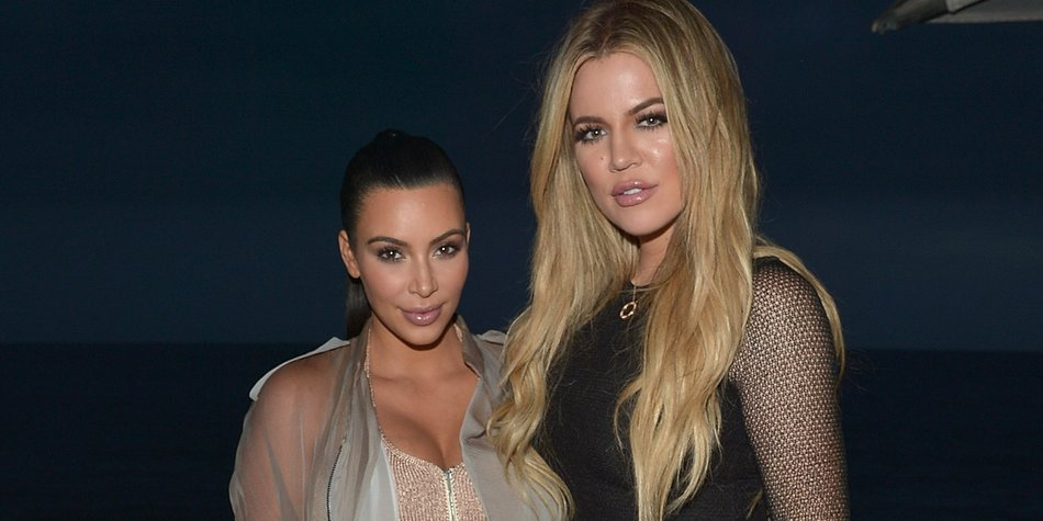 MALIBU, CA - SEPTEMBER 01: Kim Kardashian West and Khloe Kardashian attend the Kim Kardashian West,Khloe Kardashian, Kylie Jenner and Kris Jenner hosted dinner and preview of their new apps launching soon at Nobu Malibu on September 1, 2015 in Malibu, California. (Photo by Charley Gallay/Getty Images for Kardashian/Jenner Apps)