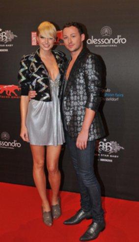 Marcel Ostertag zusammen mit Model Lena Gercke. Quelle: gettyimages
