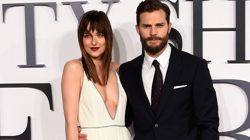 "LONDON, ENGLAND - FEBRUARY 12: Dakota Johnson and Jamie Dornan attend the UK Premiere of ""Fifty Shades Of Grey"" at Odeon Leicester Square on February 12, 2015 in London, England. (Photo by Ian Gavan/Getty Images)"