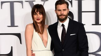 """LONDON, ENGLAND - FEBRUARY 12: Dakota Johnson and Jamie Dornan attend the UK Premiere of """"Fifty Shades Of Grey"""" at Odeon Leicester Square on February 12, 2015 in London, England. (Photo by Ian Gavan/Getty Images)"""