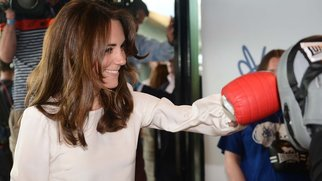 TOPSHOT - Britain's Catherine, Duchess of Cambridge tries out boxing at the launch of the Heads Together campaign on mental health at the Olympic park in London on May 16, 2016.   / AFP / POOL / JEREMY SELWYN (Photo credit should read JEREMY SELWYN/AFP/Getty Images)