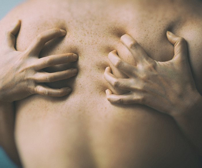 Couple in passion. Female hands on male back.