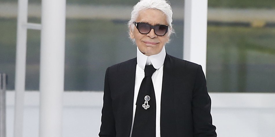 German fashion designer Karl Lagerfeld acknowledges the public at the end of the Chanel 2016 Spring/Summer ready-to-wear collection fashion show, on October 6, 2015 at the Grand Palais in Paris. AFP PHOTO / PATRICK KOVARIK (Photo credit should read PATRICK KOVARIK/AFP/Getty Images)