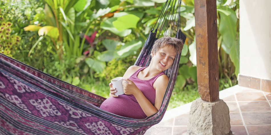 Pregnant woman in hammock