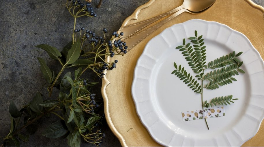 Holiday Gold place setting, napkin brown plaid, on grunge background