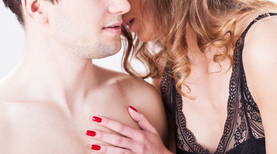Close-up of woman whispering to man's ear