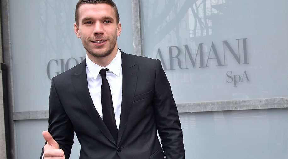 MILAN, ITALY - JANUARY 19: Lukas Podolski is seen leaving the the Emporio Armani Show as a part of Milan Menswear Fashion Week Fall Winter 2015/2016 on January 19, 2015 in Milan, Italy. (Photo by Jacopo Raule/Getty Images)