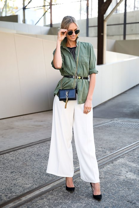 SYDNEY, AUSTRALIA - MAY 19: Nikki Phillips, wearing Watson x Watson shirt, Finders Keepers pants, Jimmy Choo heels, YSL handbag and Ray-Ban sunglasses, arrives ahead of the P.E. Nation show at Mercedes-Benz Fashion Week Resort 17 Collections at Carriageworks on May 19, 2016 in Sydney, New South Wales. (Photo by Caroline McCredie/Getty Images)