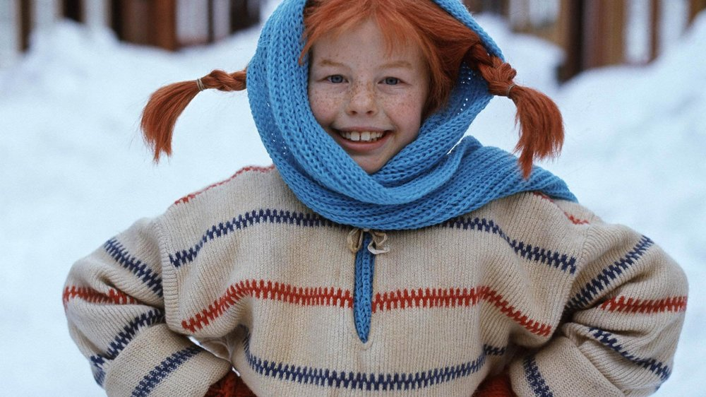 """TO GO WITH AFP STORY BY DELPHINE TOUITOU (FILES) A file photo taken 23 February 1968 shows a still from the movie """"Pippi Longstocking"""" with Inger Nilsson as Pippi. Swedish writer Astrid Lindgren, who would have been 100 14 November 2007, still enjoys worldwide success with her children's books, which like her most famous character Pippi Longstocking do not seem to have aged a bit. Born 14 November 1907 in the southeastern Swedish town of Vimmerby, the writer revolutionized the world of children's books with such beloved characters as Emil of Maple Hill, Madicken, Karlsson-on-the Roof and Ronia the Robber's Daughter. AFP PHOTO / JACOB FORSELL (Photo credit should read JACOB FORSELL/AFP/Getty Images)"""