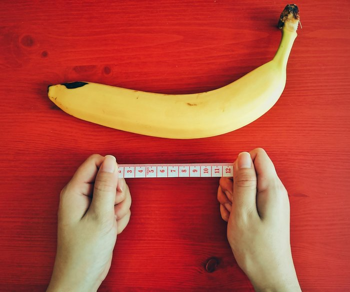Measuring a Banana on a Sharp Red Table.