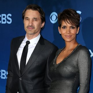 "LOS ANGELES, CA - JUNE 16: Actress Halle Berry (R) and her husband Oliver Martinez attend the Premiere of CBS Television Studios & Amblin Television's ""Extant"" at the California Science Center on June 16, 2014 in Los Angeles, California. (Photo by Frederick M. Brown/Getty Images)"
