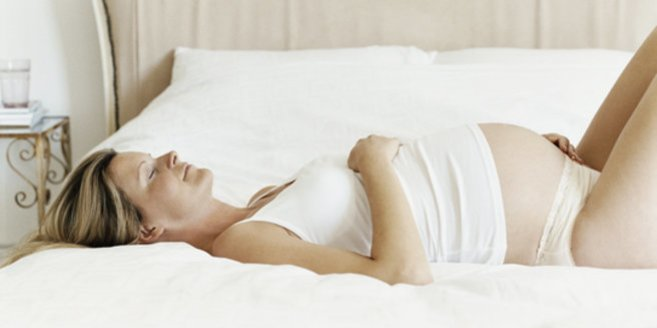 Muttermund: Eine schwangere Frau.
