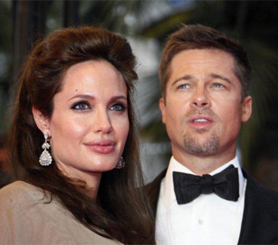 Brad Pitt und seine Angelina Jolie und Sohn Maddox