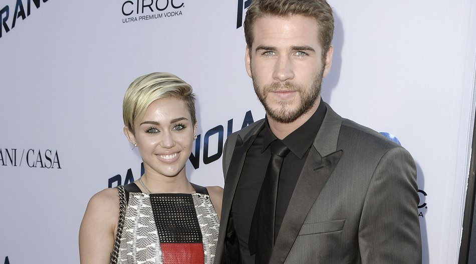 "LOS ANGELES, CA - AUGUST 08: Actress Miley Cyrus and actor Liam Hemsworth attend the premiere of Relativity Media's ""Paranoia"" at the DGA Theater on August 8, 2013 in Los Angeles, California. (Photo by Kevin Winter/Getty Images)"