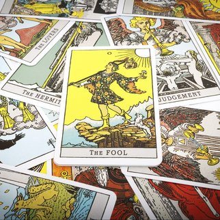 Tarot cards Tarot, the fool card in the foreground.