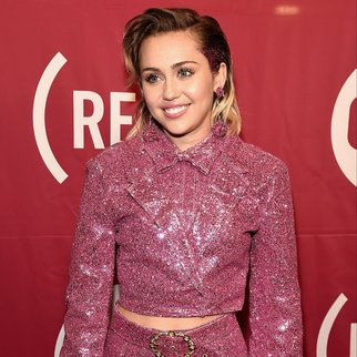 """NEW YORK, NY - DECEMBER 01:  Singer Miley Cyrus attends the ONE Campaign and (RED)'s """"It Always Seems Impossible Until It Is Done"""" 10th anniversary celebration at Carnegie Hall on December 1, 2015 in New York City.  (Photo by Theo Wargo/Getty Images)"""
