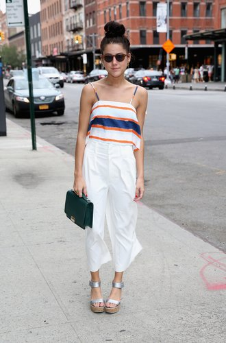 NEW YORK, NY - SEPTEMBER 13: Blogger and stylist of A Vintage Vice @avintagevice Emma Sousa is wearing Elle Sasson top, Apiece Apart Culottes, Calvin Klein sandal, Lauren Merkin bag, Garrett Leight sunnies outside NYFW: The Shows HQ during Spring 2016 New York Fashion Week on September 13, 2015 in New York City. (Photo by Robin Marchant/Getty Images)