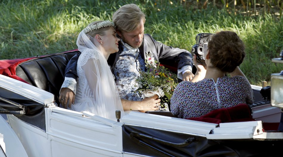 EFRINGEN-KIRCHEN, GERMANY - AUGUST 27: Bridal pair Samuel Koch and Sarah Elena Timpe get photos taken while they ride a carriage after the wedding at the local church to go to their party on August 27, 2016 near Efringen-Kirchen, Germany. (Photo by Andreas Rentz/Getty Images)