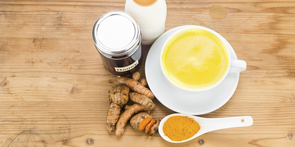 Turmeric roots with milk and honey drinks for beauty and health