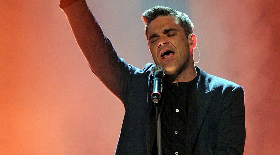"""Robbie Williams arbeitet momentan an dem Nachfolger zu seiner Platte """"Swing When You're Winning"""". Fans können sich dabei auf ein hochkarätiges Duett freuen."""