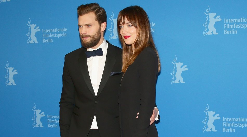 BERLIN, GERMANY - FEBRUARY 11: Jamie Dornan and Dakota Johnson attend the 'Fifty Shades of Grey' premiere during the 65th Berlinale International Film Festival at Zoo Palast on February 11, 2015 in Berlin, Germany. (Photo by Vittorio Zunino Celotto/Getty Images)