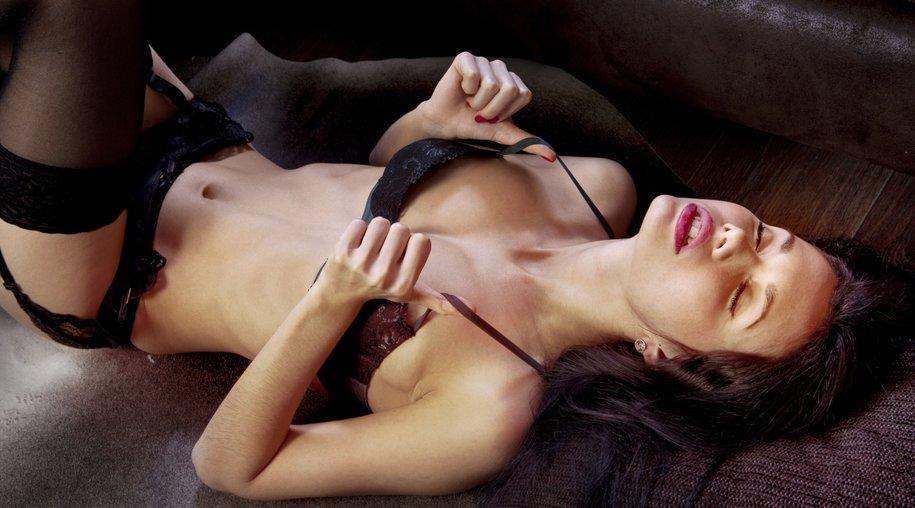 voluptuous girl in underwear derives pleasure on floor