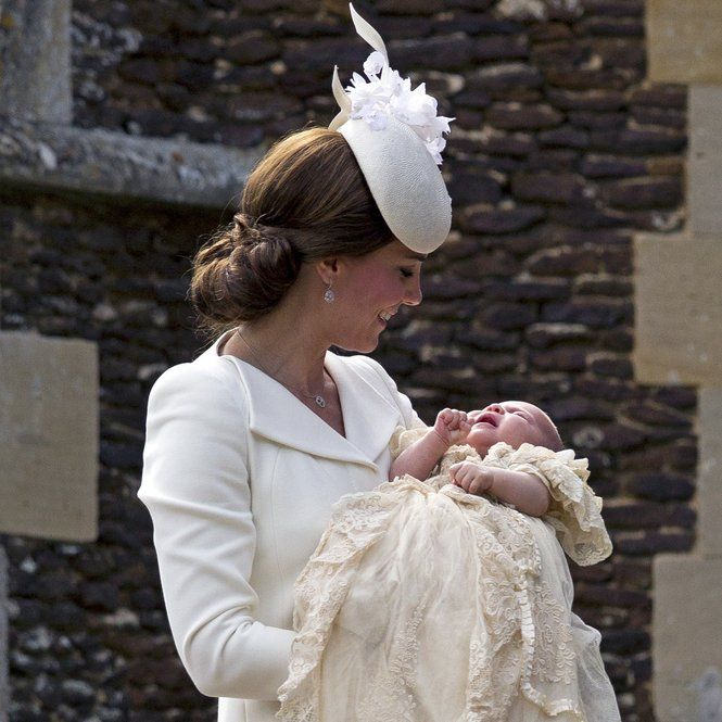 KING'S LYNN, ENGLAND - JULY 05:  Catherine, Duchess of Cambridge, carries Princess Charlotte of Cambridge as they arrive at the Church of St Mary Magdalene on the Sandringham Estate for the Christening of Princess Charlotte of Cambridge on July 5, 2015 in King's Lynn, England.  (Photo by Matt Dunham - WPA Pool /Getty Images)