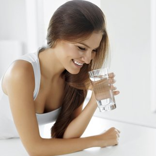 Health, Beauty, Diet Concept. Portrait Of Happy Smiling Young Woman Drinking Refreshing Water In The Morning. Healthcare. Drinks. Healthy Eating. Healthy Lifestyle.