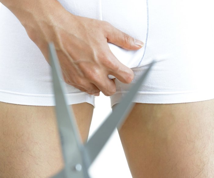 Scissors in front of man wearing underwear - adultery concept