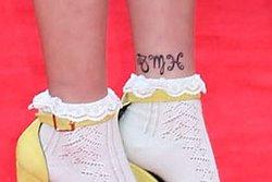 Sternzeichen Tattoo am Fuß