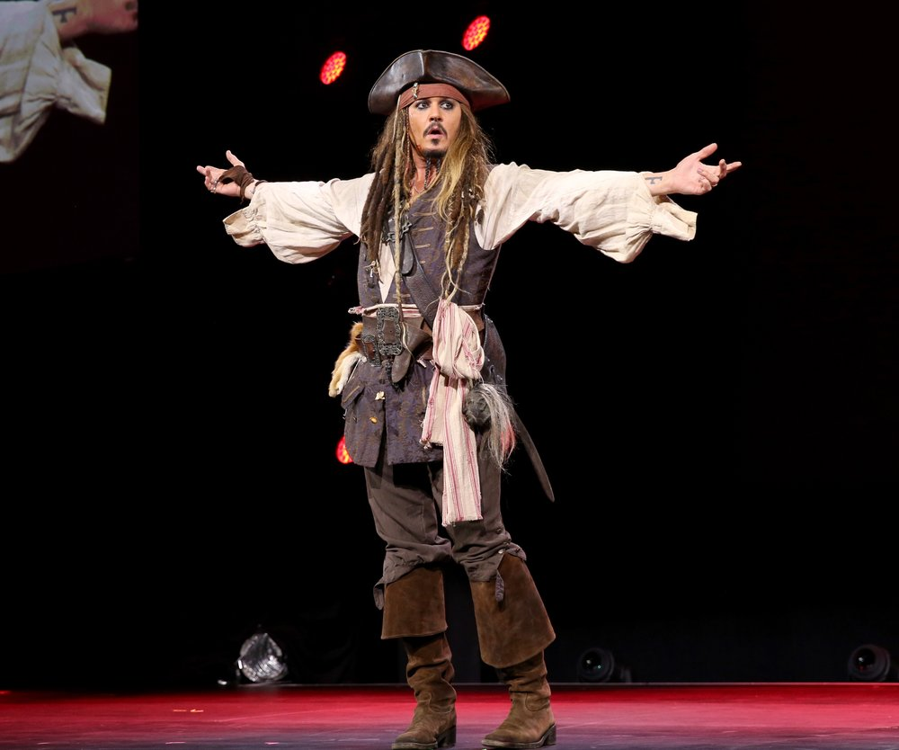 "ANAHEIM, CA - AUGUST 15: Actor Johnny Depp, dressed as Captain Jack Sparrow, of PIRATES OF THE CARIBBEAN: DEAD MEN TELL NO TALES took part today in ""Worlds, Galaxies, and Universes: Live Action at The Walt Disney Studios"" presentation at Disney's D23 EXPO 2015 in Anaheim, Calif. (Photo by Jesse Grant/Getty Images for Disney)"