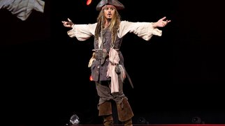 """ANAHEIM, CA - AUGUST 15: Actor Johnny Depp, dressed as Captain Jack Sparrow, of PIRATES OF THE CARIBBEAN: DEAD MEN TELL NO TALES took part today in """"Worlds, Galaxies, and Universes: Live Action at The Walt Disney Studios"""" presentation at Disney's D23 EXPO 2015 in Anaheim, Calif. (Photo by Jesse Grant/Getty Images for Disney)"""